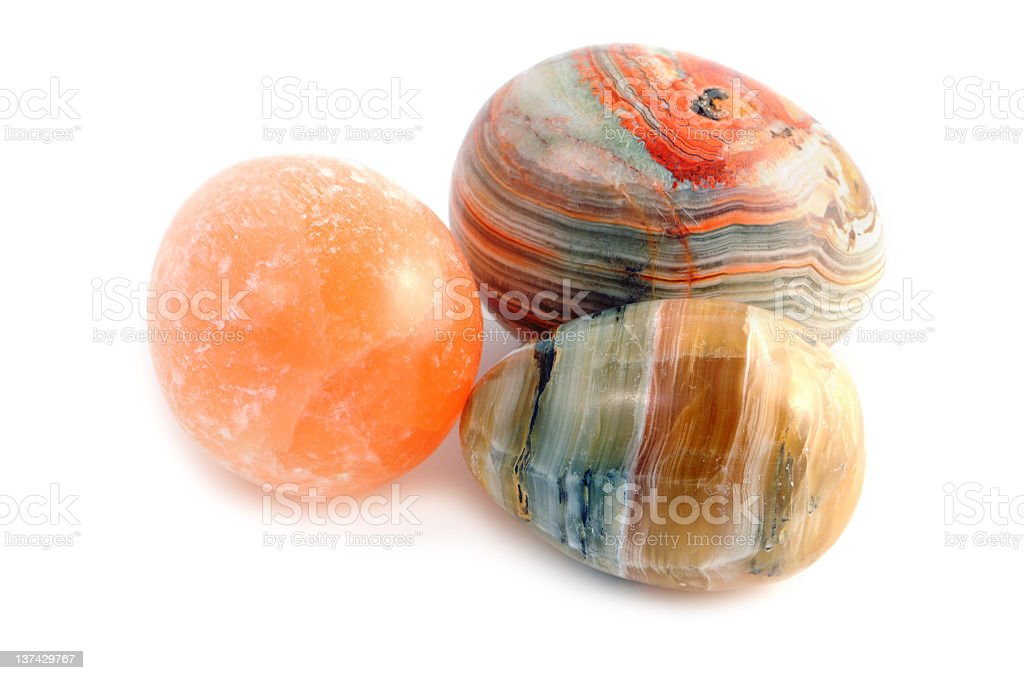 multicolor eggs made of agate on white background stock photo