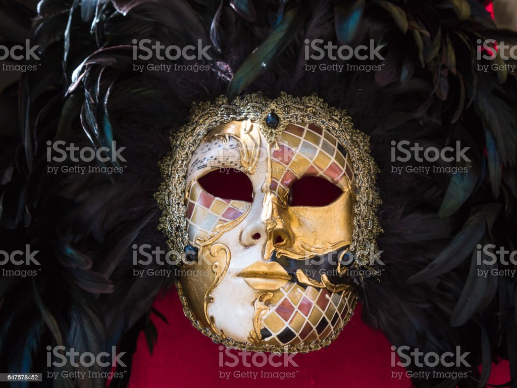 Multicolor Handmade Carnival Venetian Masks on red BackGround stock photo