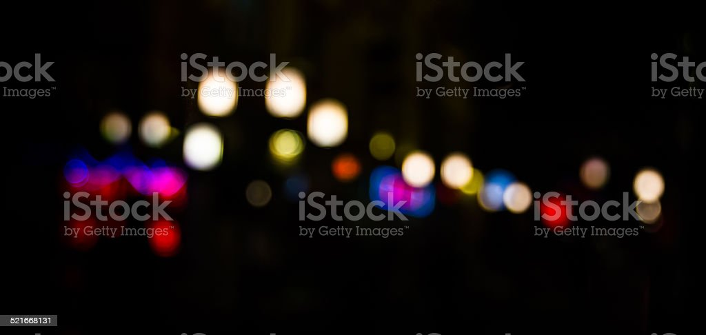 multicolor night light bokeh on black background stock photo
