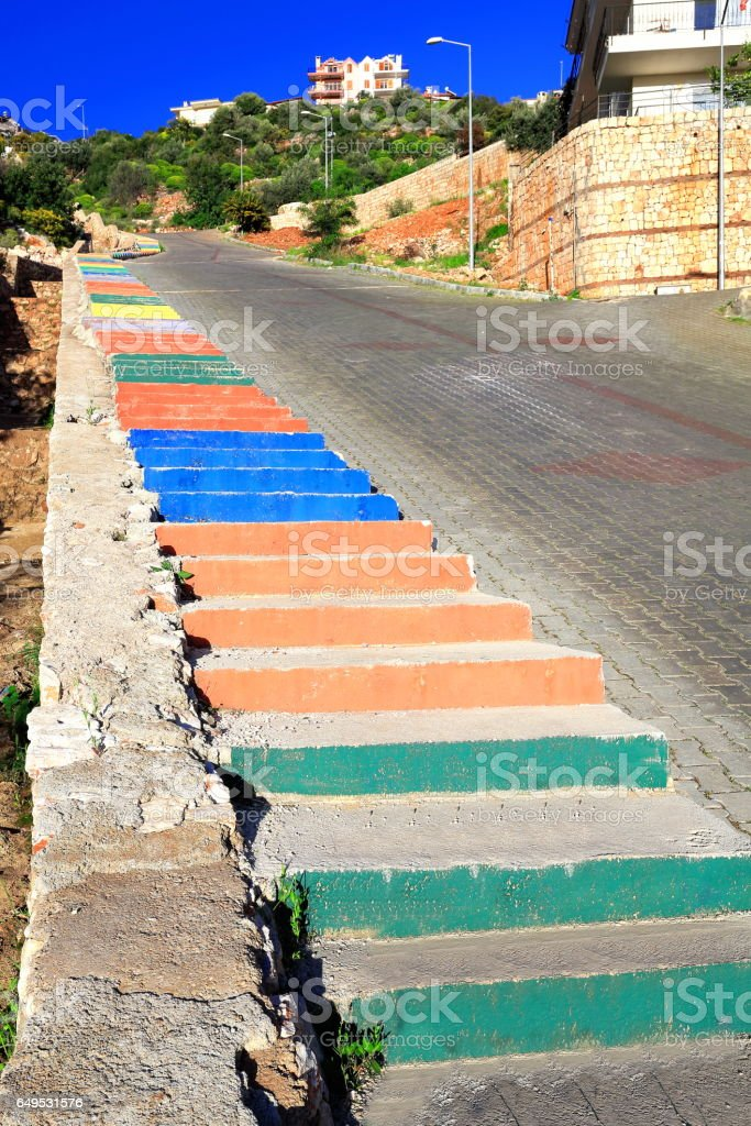 Multicolor staircase-sidewalk of steep street leading to the uptown. Kas-Turkey. 1816 stock photo