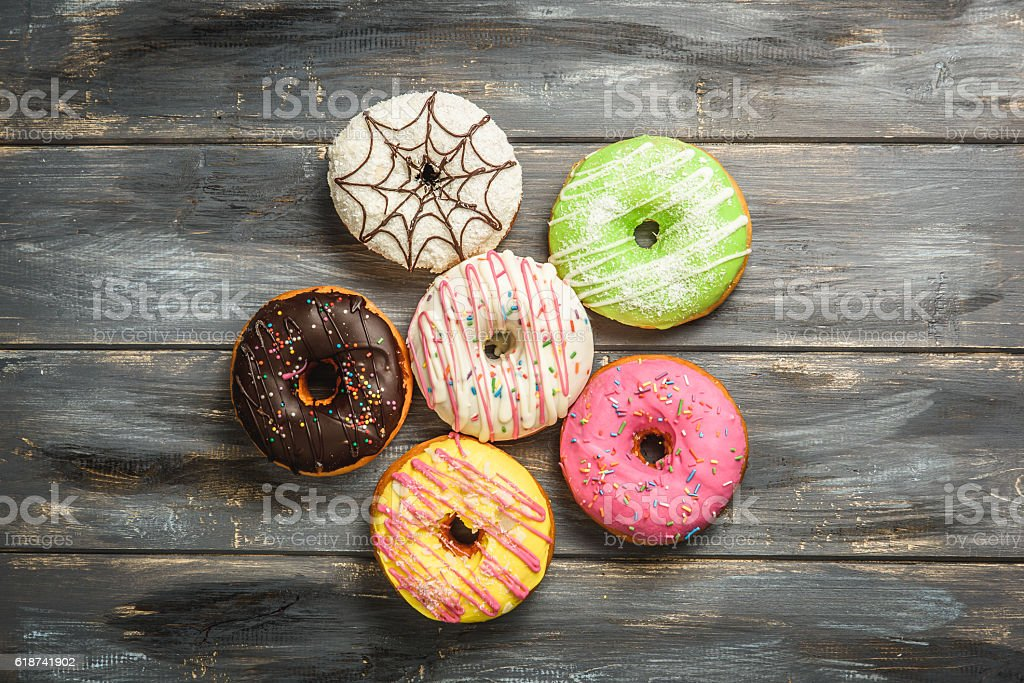 Multi-colored assortment of donuts stock photo