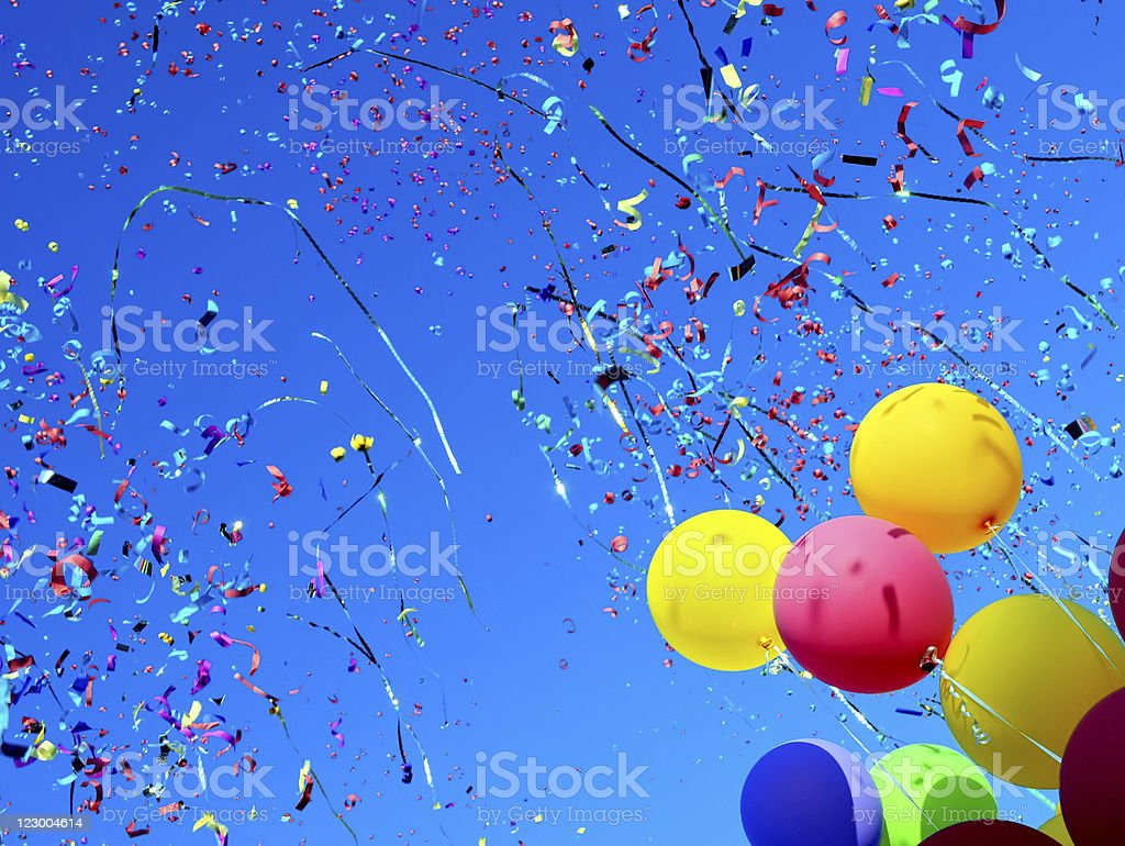 multicolored balloons and confetti stock photo
