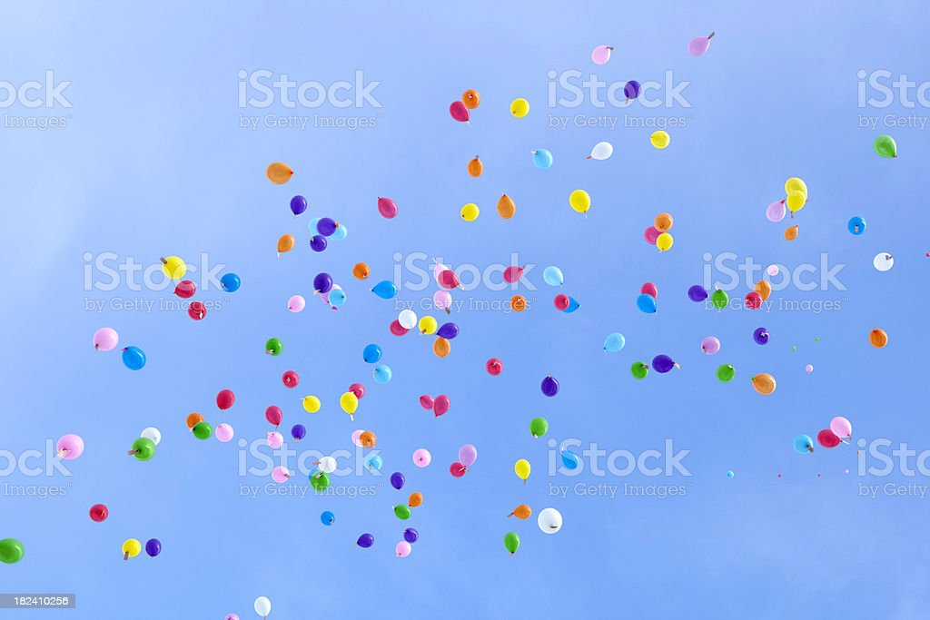 Multicolored balloons flying away royalty-free stock photo