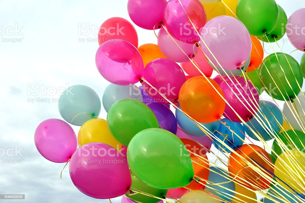 multicolored balloons in the city festival stock photo