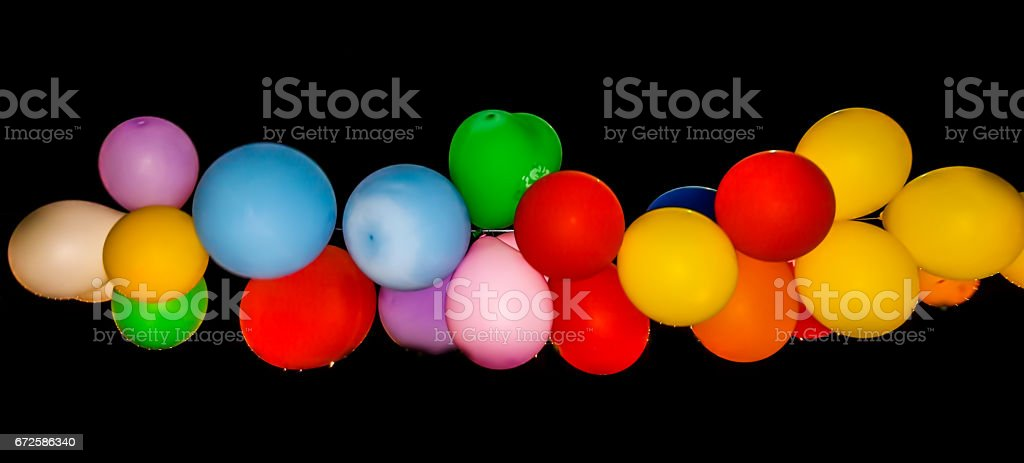 Multicolored balloons on black a background stock photo