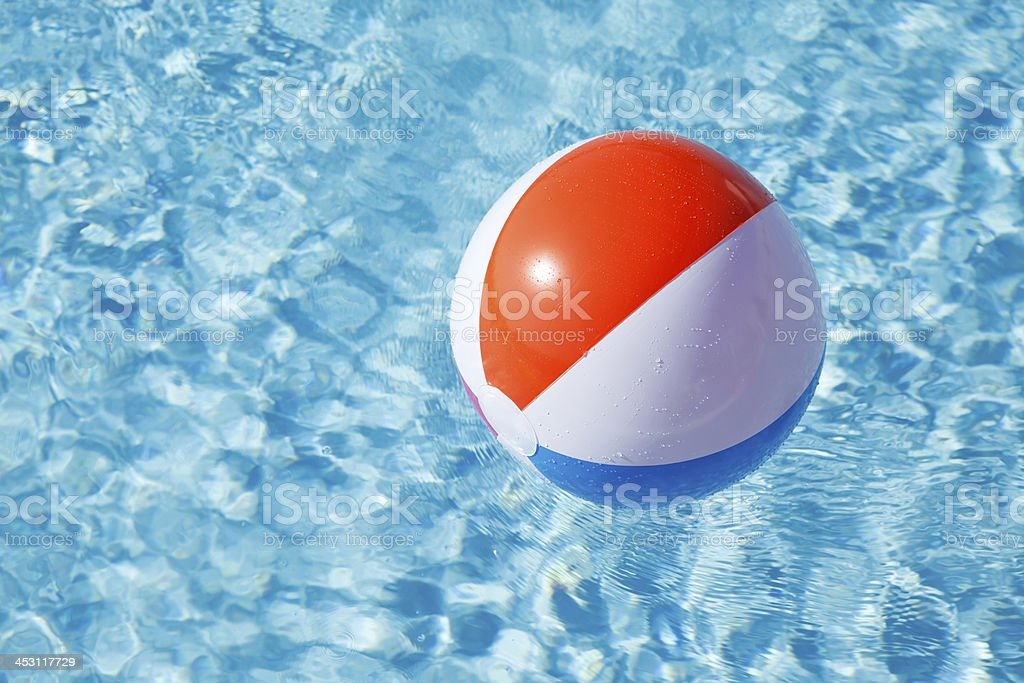 Multicolored Beach Ball Floating on Pool Water royalty-free stock photo