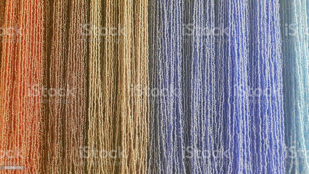 Multicolored bead strands stock photo