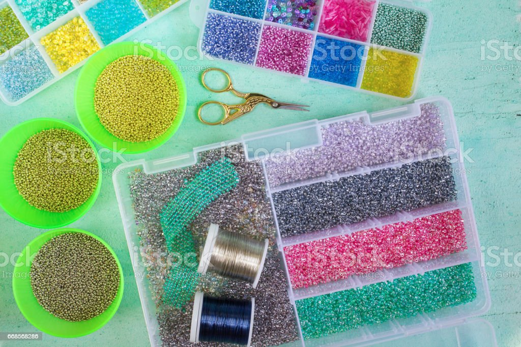 Multi-colored beads,wire and scissors stock photo