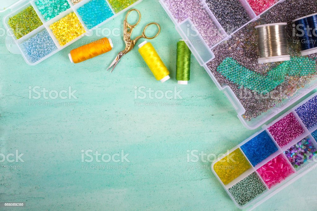 Multi-colored beads,wire,coil and scissors stock photo
