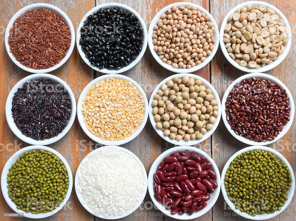 Multicolored beans in ceramics bowl stock photo