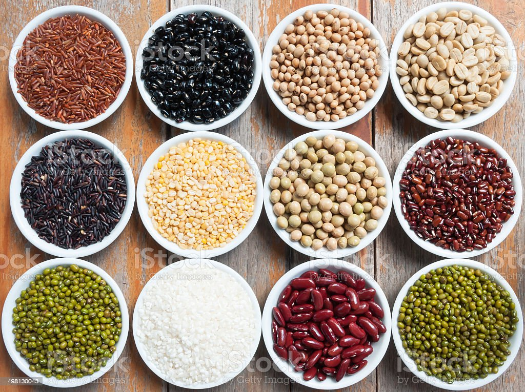 Multicolored beans in ceramics bowl stock photo