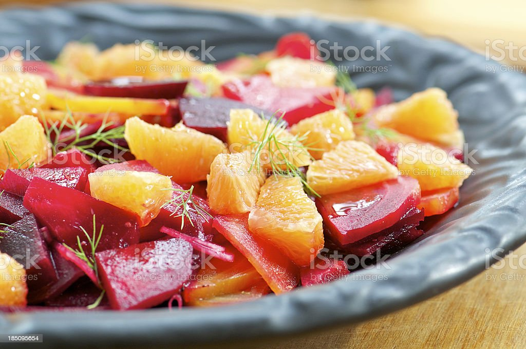 Multi-Colored Beet and Orange Salad on Black Plate stock photo