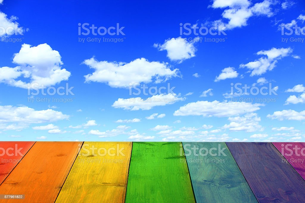multicolored bright stand from wooden boards and sky stock photo