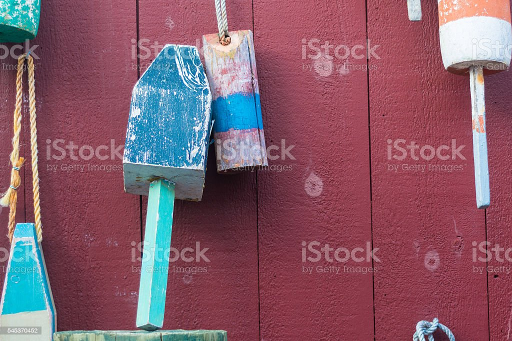 Multicolored buoys on display stock photo