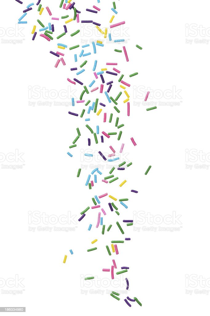 Multicolored candy sprinkles on white background stock photo