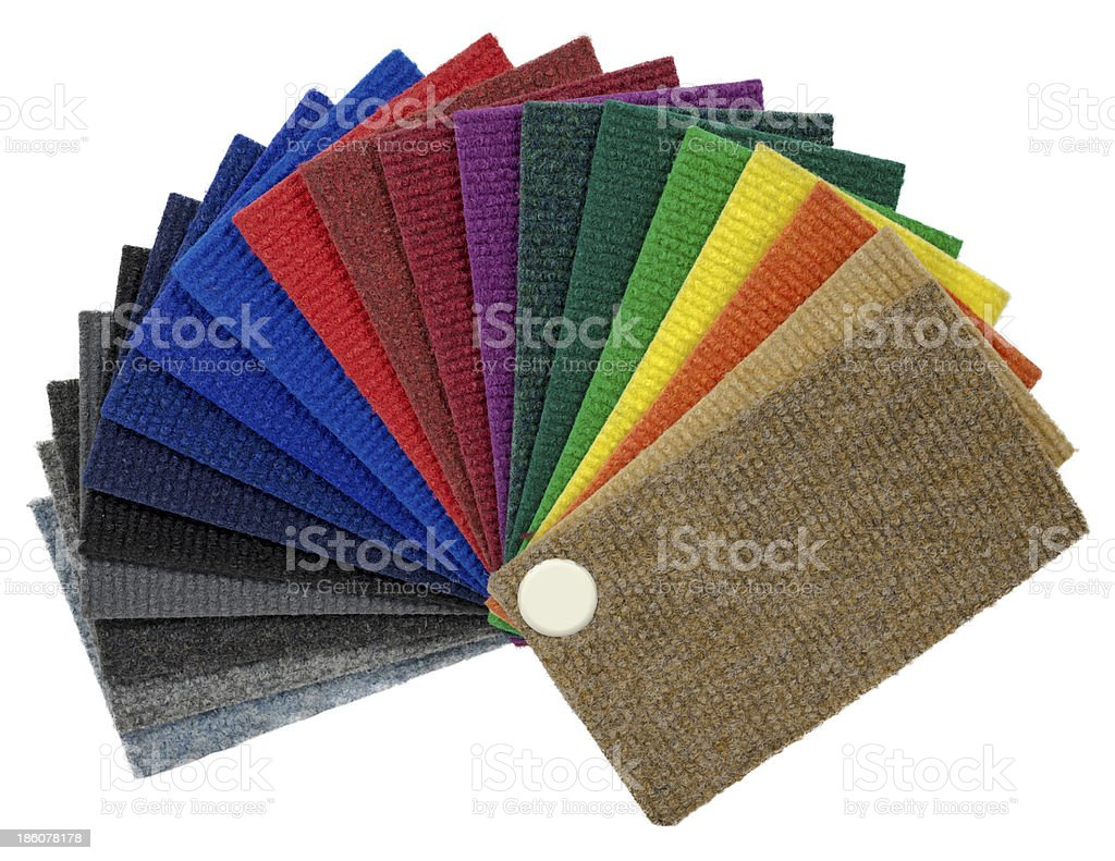 Multi-colored carpeting samples by a fan stock photo