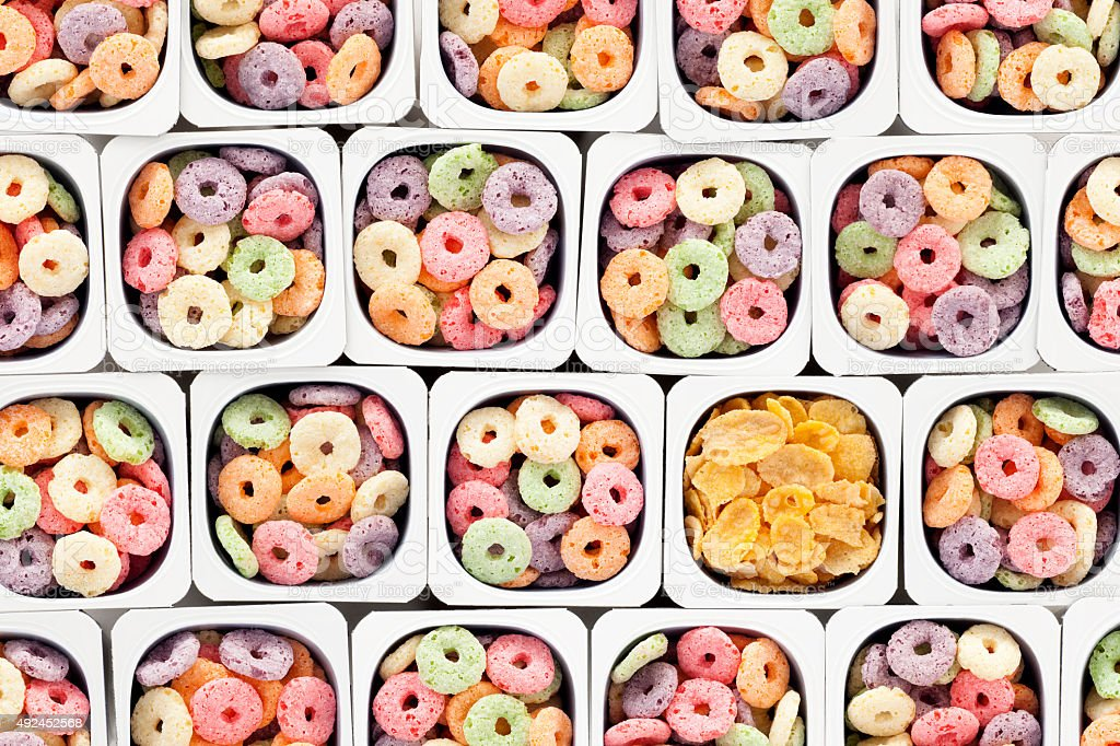 Multicolored cereal rings and cornflakes stock photo