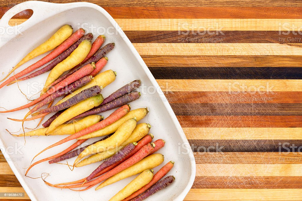 Multicolored colorful carrots on a platter stock photo
