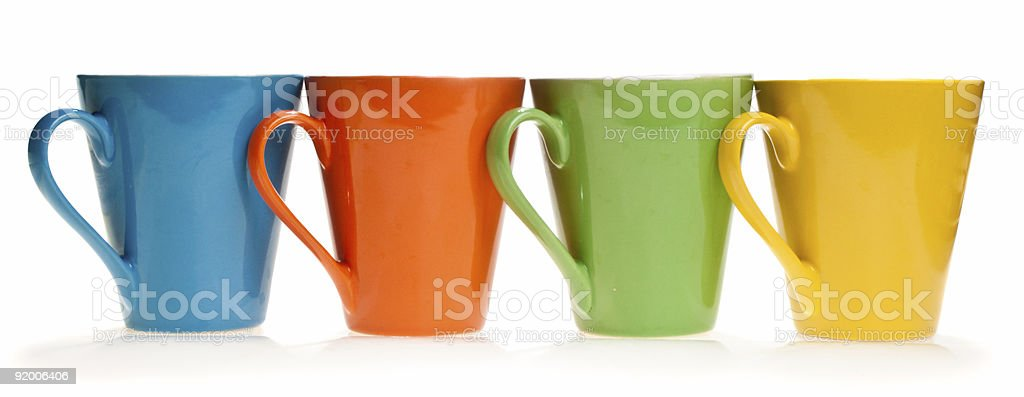 Multicolored cups in a row, isolated royalty-free stock photo