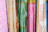 Multi-colored curtains on background.