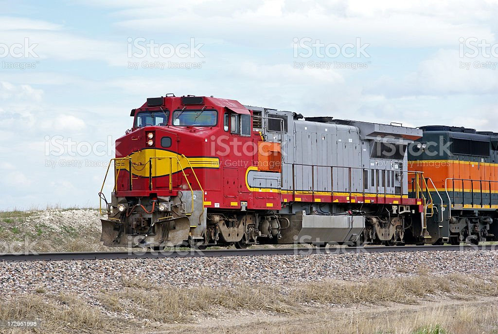 Multicolored diesel locomotive on a track  stock photo
