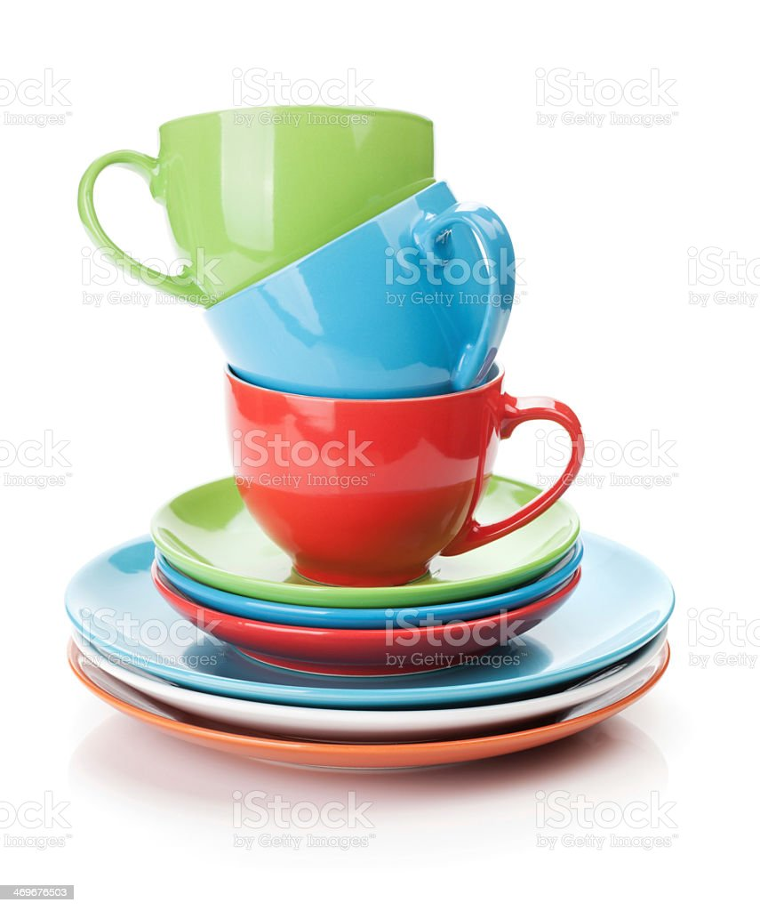 Multicolored dishes on a white background stock photo