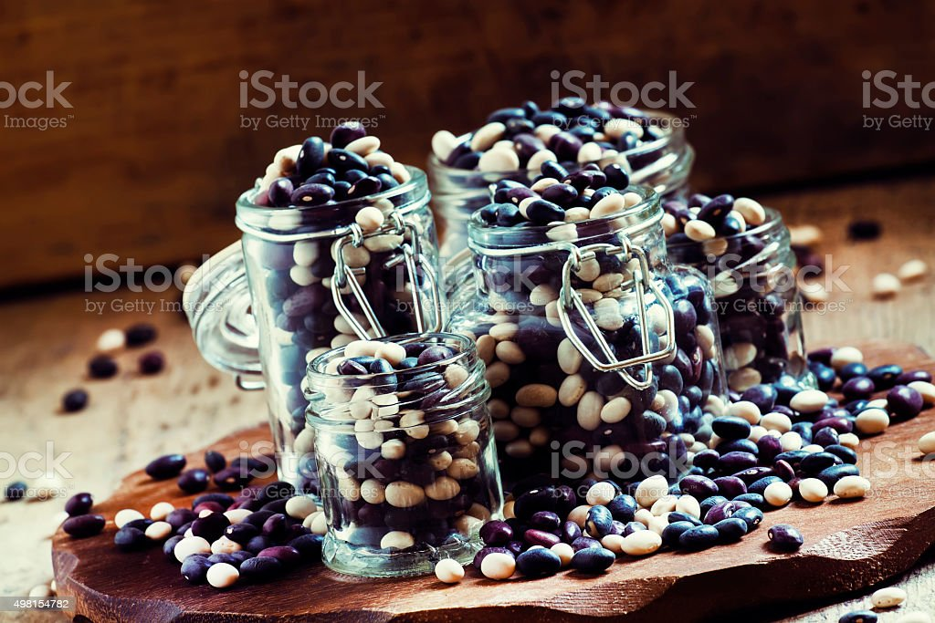 multi-colored dry beans in glass jar stock photo