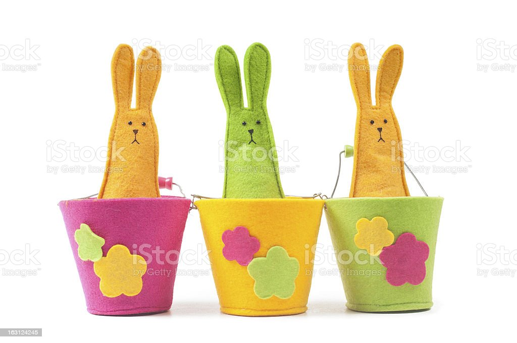 Multicolored easter bunnies sitting in row royalty-free stock photo