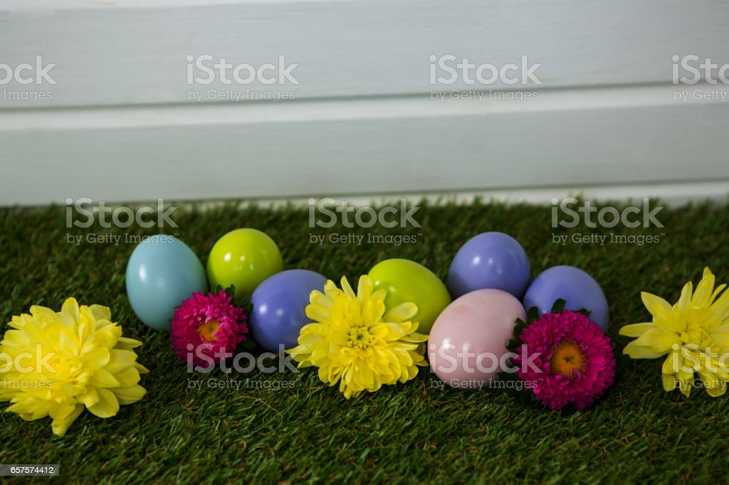 Multicolored Easter egg on grass stock photo