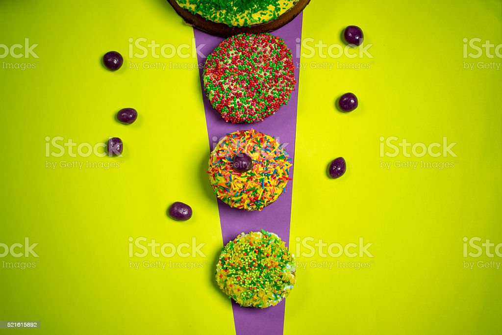 multicolored easter gingerbread cakes, sugar candies, bright  background, celebration photography stock photo