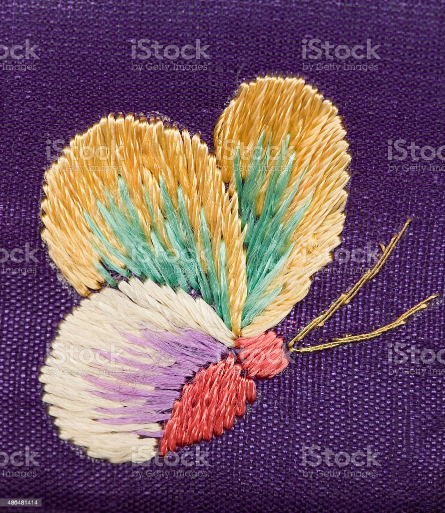 Multicolored embroidered slik butterfly stock photo