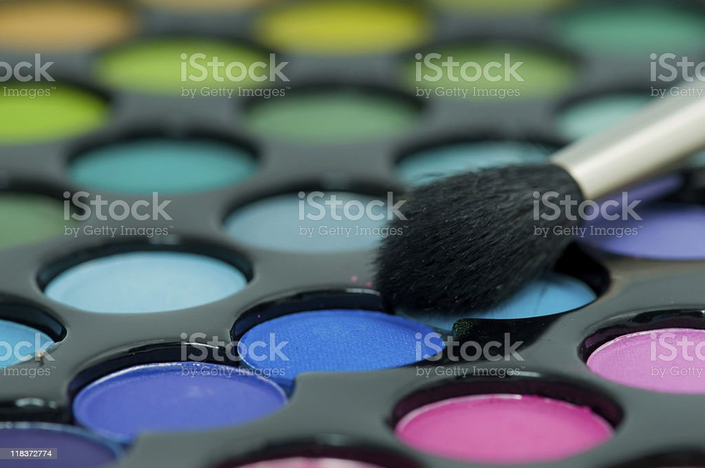 multicolored eye shadows with cosmetics brush. royalty-free stock photo