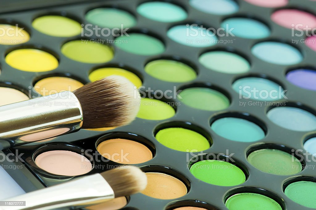 multicolored eye shadows with cosmetics brush royalty-free stock photo