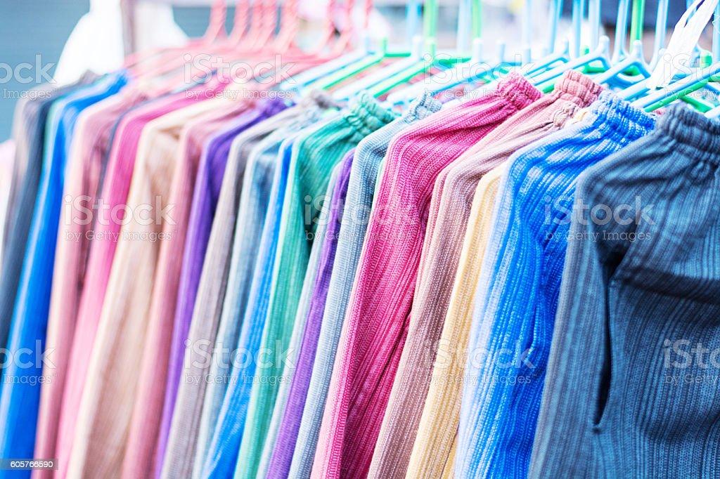 Multicolored fabric in outdoor market stock photo