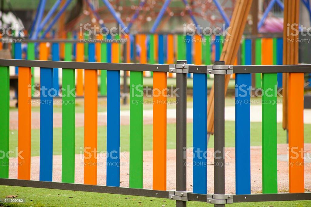 Multicolored Fence around playground. stock photo