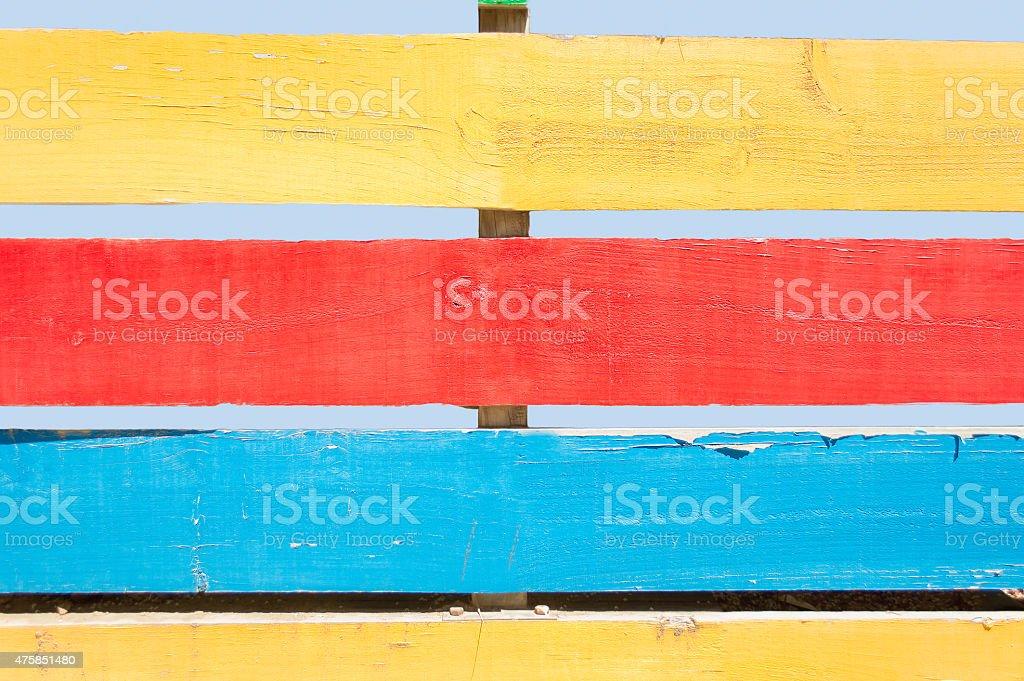 multicolored fence stock photo