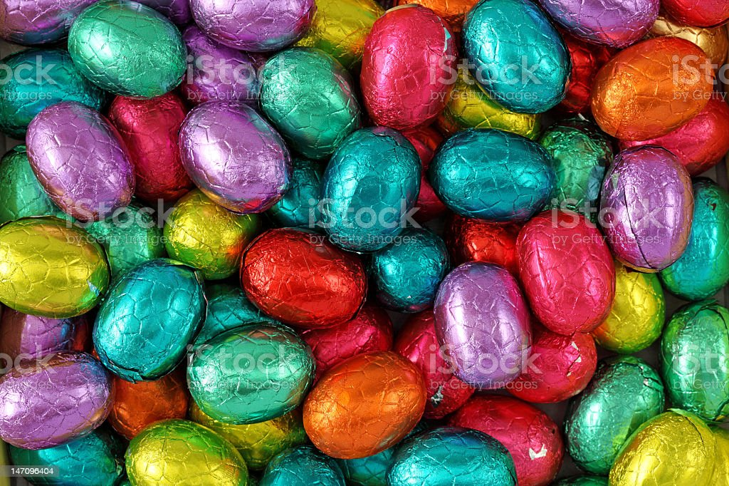 Multicolored foil wrapped chocolate egg shaped candies stock photo