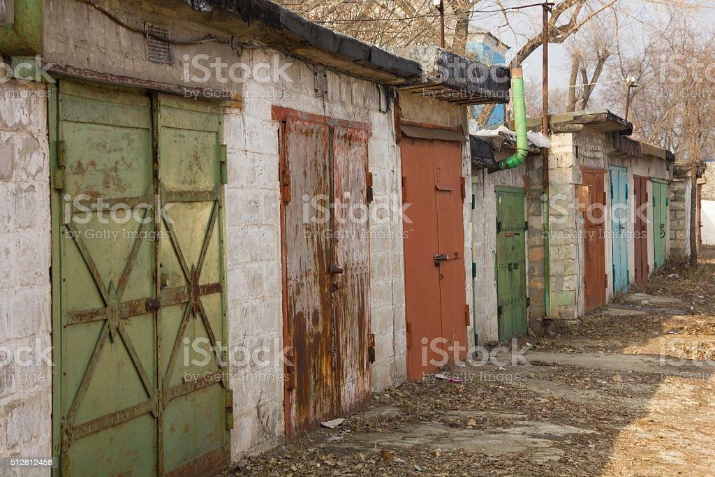 Multi-colored garage doors in a quiet area stock photo
