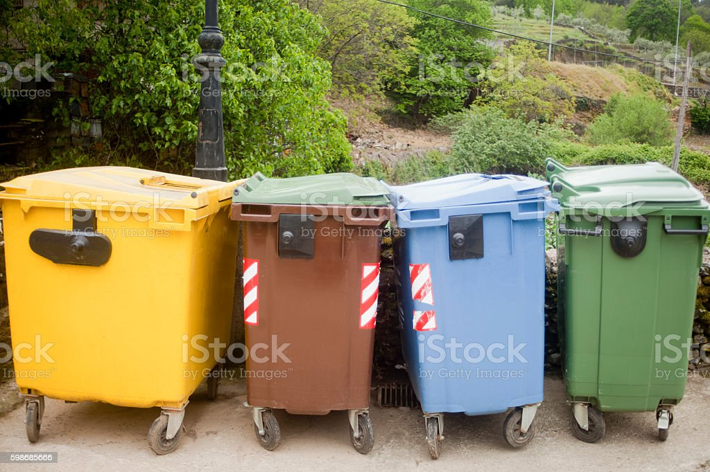 Multicolored garbage bins for recycling. stock photo