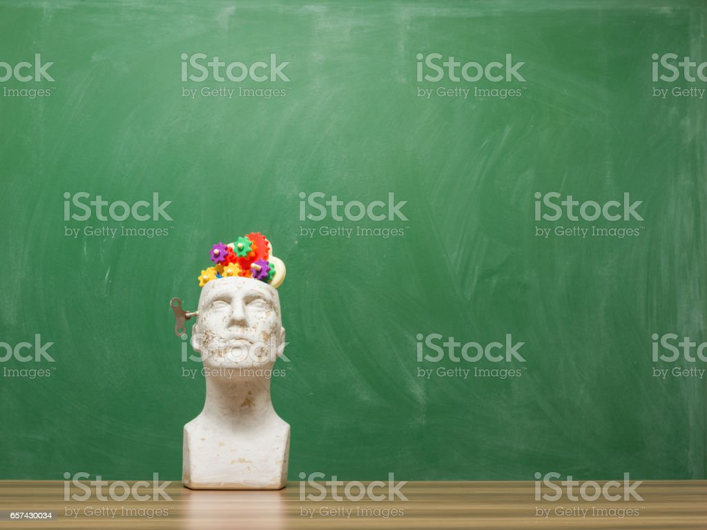 Multicolored Gears In Mannequin Head On Time Concept background stock photo