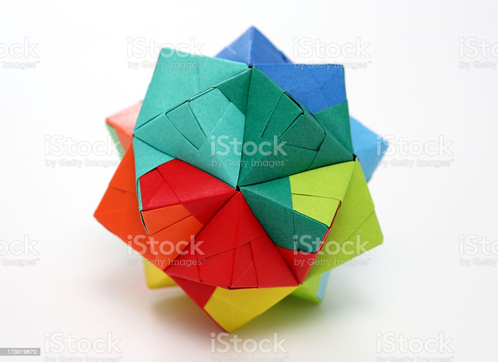 Multicolored geometric origami polyhedron isolated on white stock photo