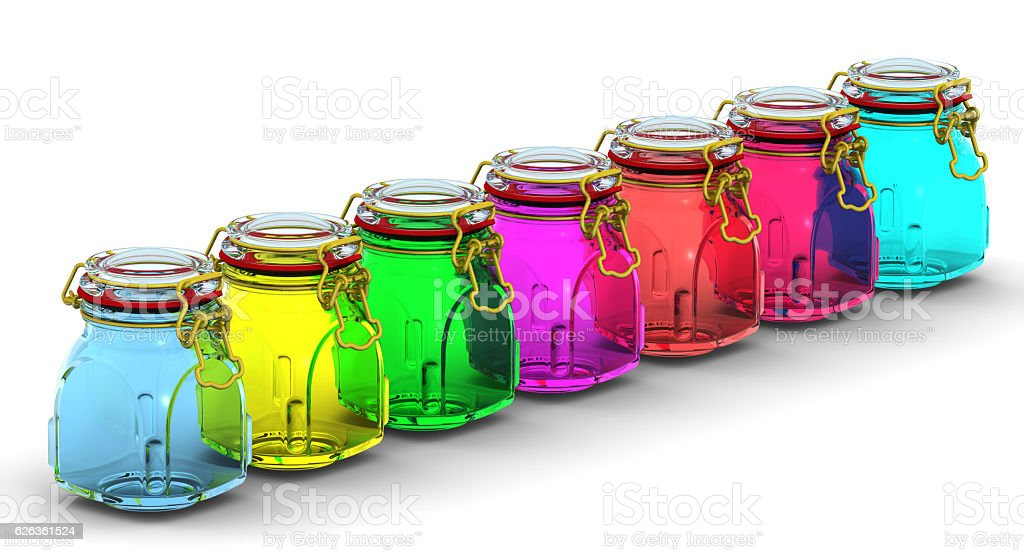 Multicolored glass jars for canning stock photo