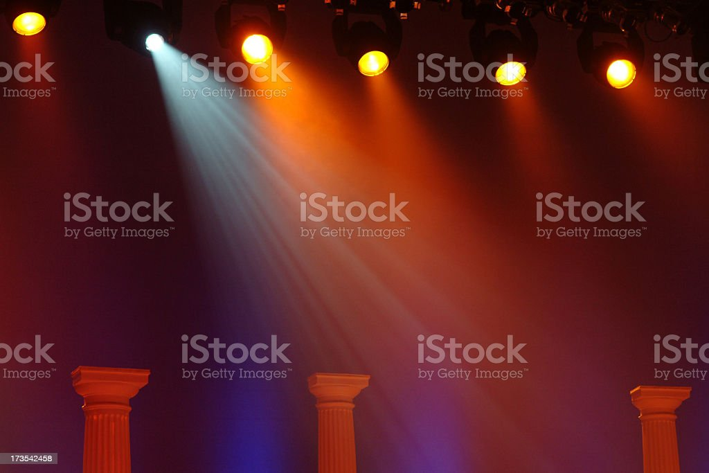 Multicolored Glowing Stage Lights with a Dark Background stock photo