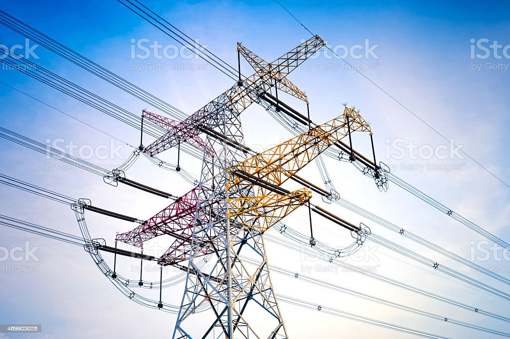 A multi-colored high voltage communications tower stock photo