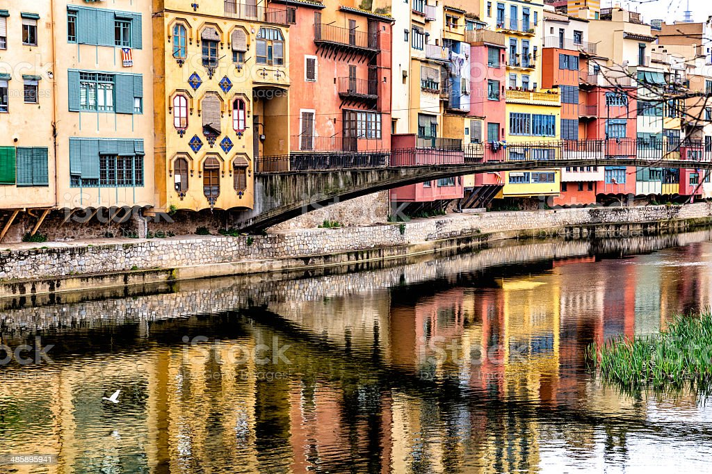 Multicolored houses and apartments by Onyar riverside Gerona Catalonia Spain stock photo