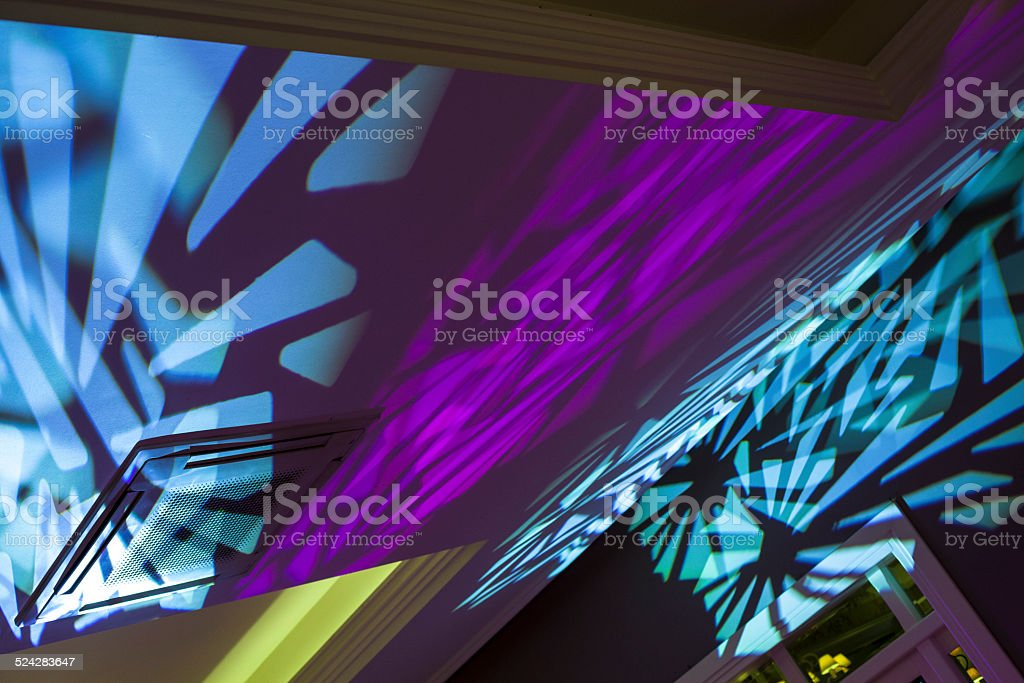Multicolored laser lights on the wall stock photo