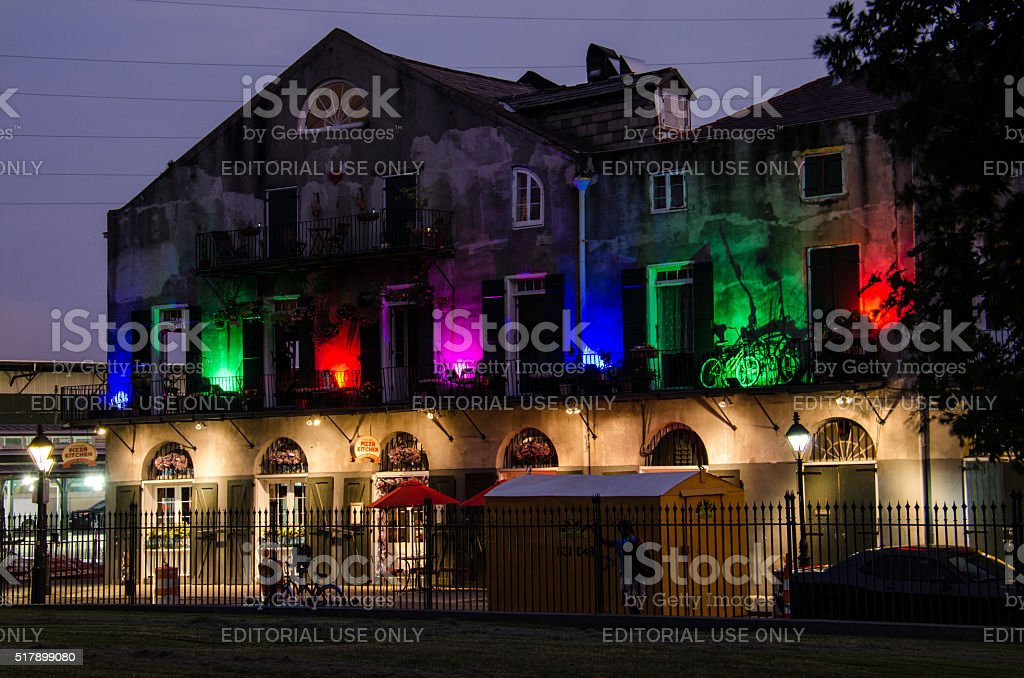 Multicolored lights building in French Quarter, New Orleans. stock photo