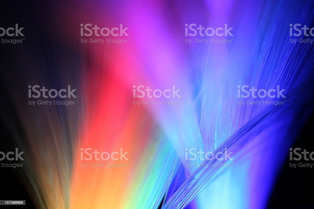 Multicolored lights shining in the night stock photo