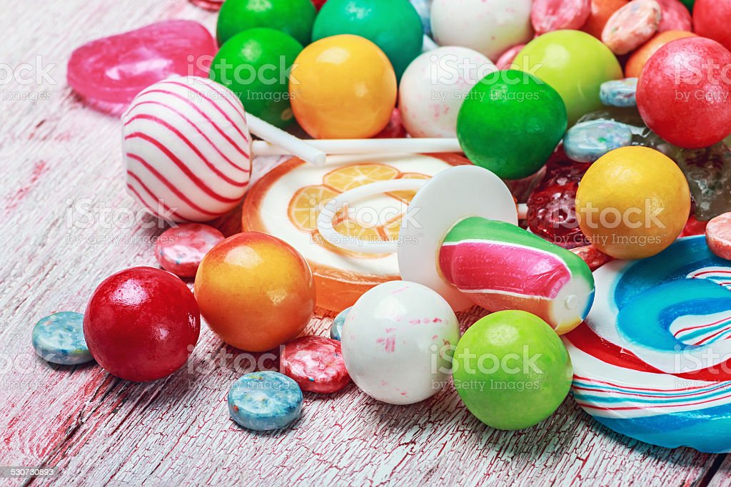 multicolored lollipops and candy stock photo