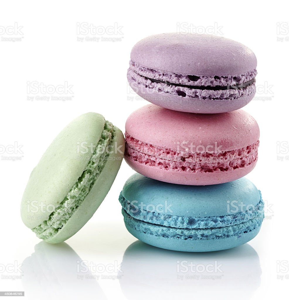 4 multicolored macaroons stacked stock photo